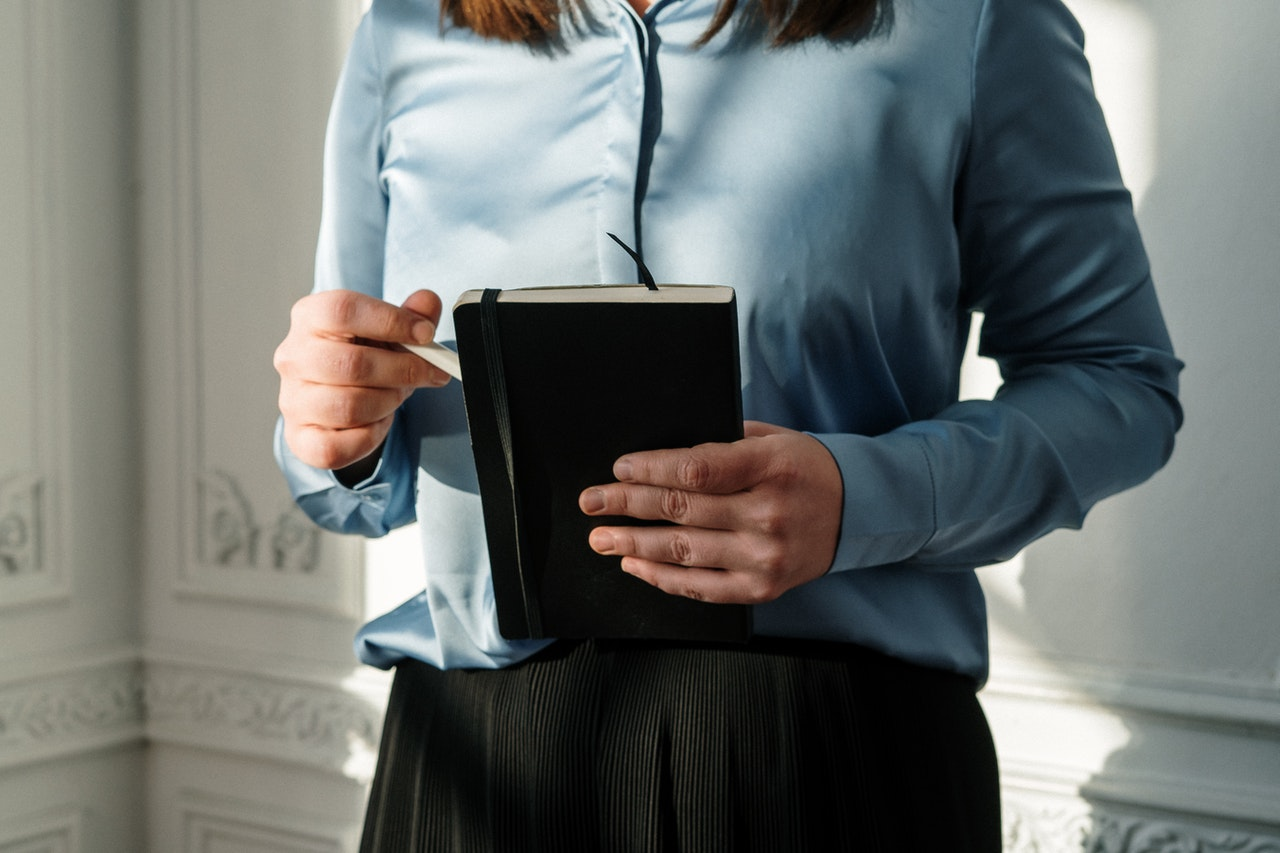 Therapist holding a notepad